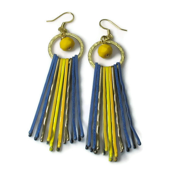 These fun upcycled earrings from BluKat Design would compliment perfectly with any fashionista's wardrobe!