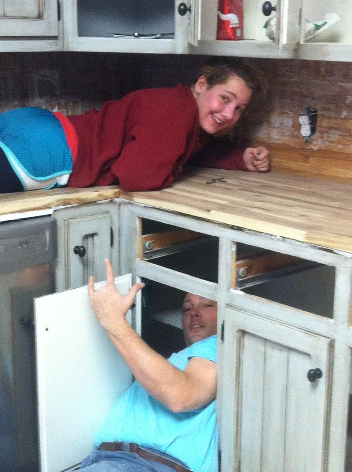 My dad and I installing the new butcher block counter tops in the kitchen. Cannot wait to see them all polished and looking fantastic!
