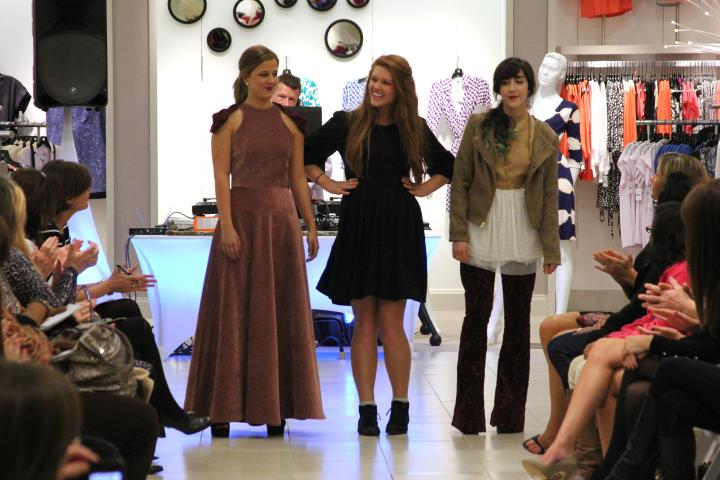 Kalie Smith very excited to see her models finish their walk down the runway. Both frocks are so awesome!