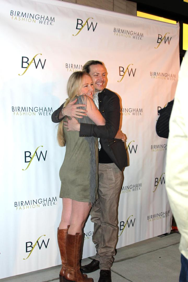 Jeremy and Heidi having fun posing at the BFW Kick Off Party at Gus Mayer.