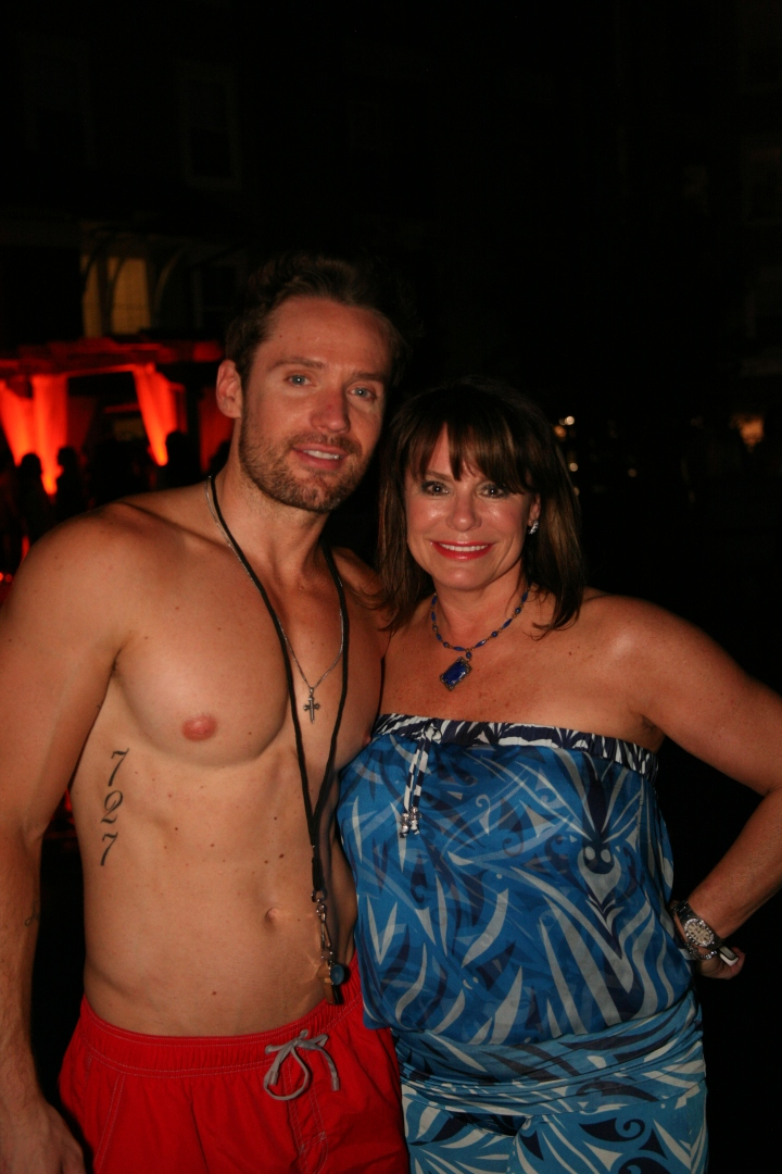 Dona Bullock (owner and master stylist at Joelle Salon) with poolside hottie, Scott Edward Fell.