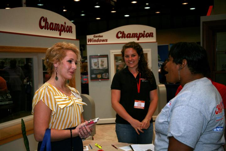 Wendy from Champion and the VIP chatting at the Birmingham Home Show 2013.