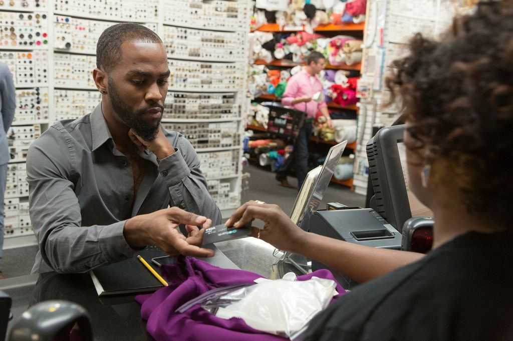 Ken purchasing his fabric at Mood with his GoBank card. Image provided by The Weinstein Company.