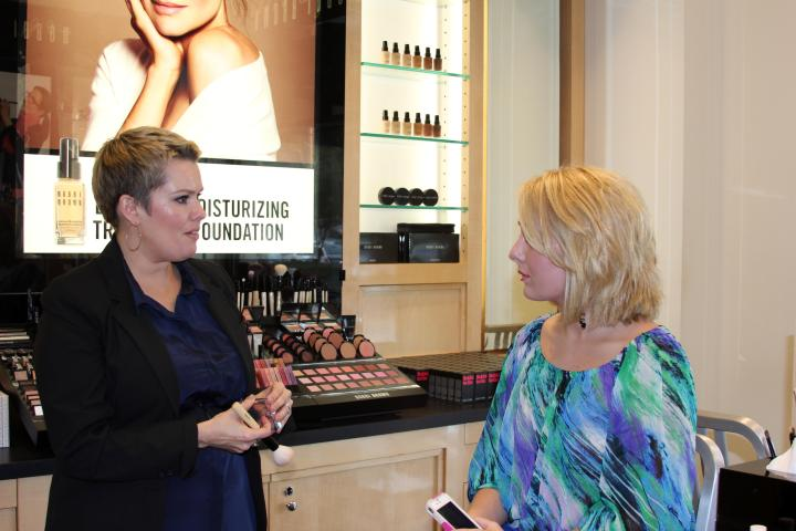 The VIP chatting with MUA Carrie Wilson at Saks Fifth Avenue Birmingham.