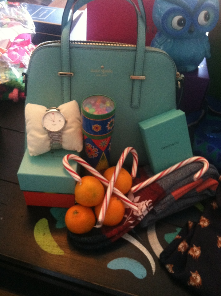 Santa also got me some amazing Kate Spade goodies! A new watch, purse, and stamp for letters! Yay!