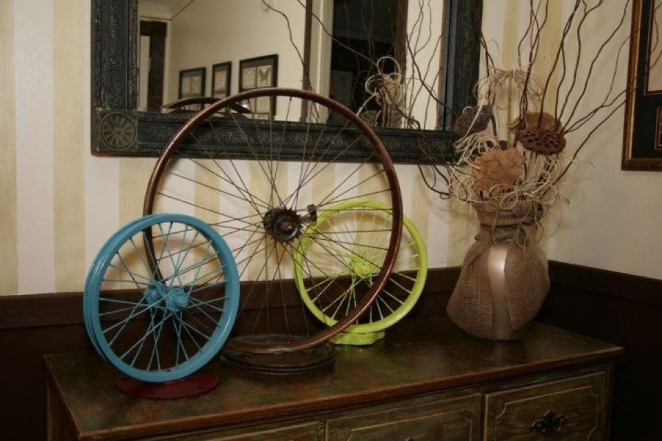 A small peek at the dresser when it was in the living room of the Mississippi house. I always loved the way my mom decorated the top with her artwork. The bicycle wheel sculptures are some of my favorite!