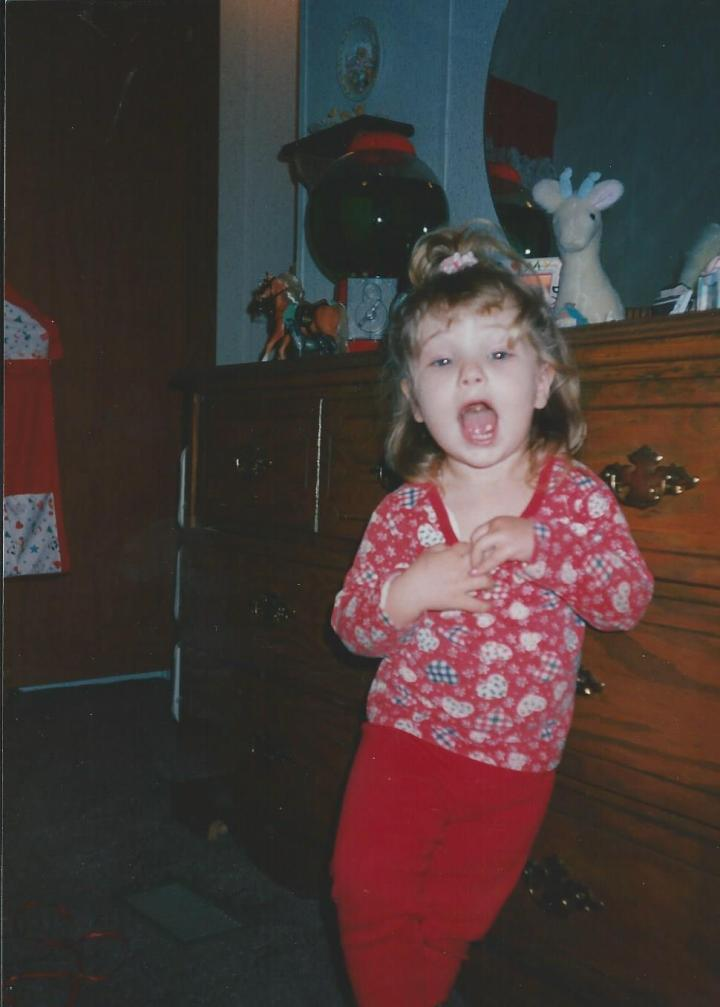 La! La! La! Check out this silly photo that my mom took of me when I was little--haha too funny! Also, check out the dresser in the back ground *wink*
