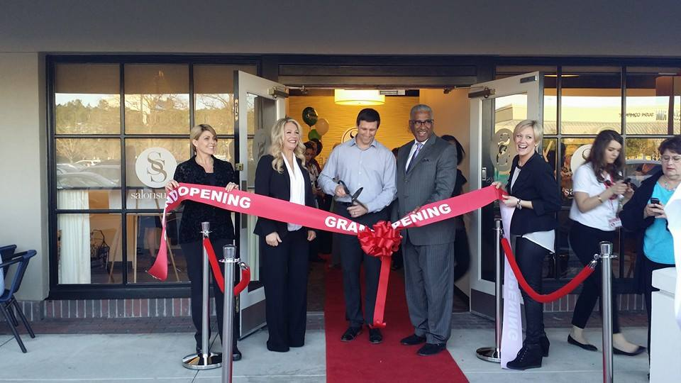 The Salon Suites ribbon cutting with Mayor Bell.