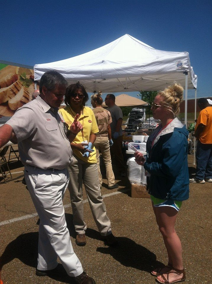 The VIP chatting with Mike Smith and Cyd Landing of Tyson Food INC.