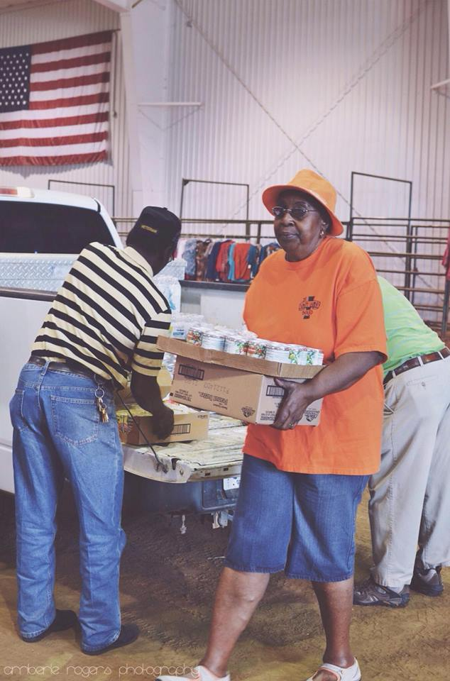 Photo Credit: Amberle Rogers Volunteers working hard at the Louisville Coliseum.