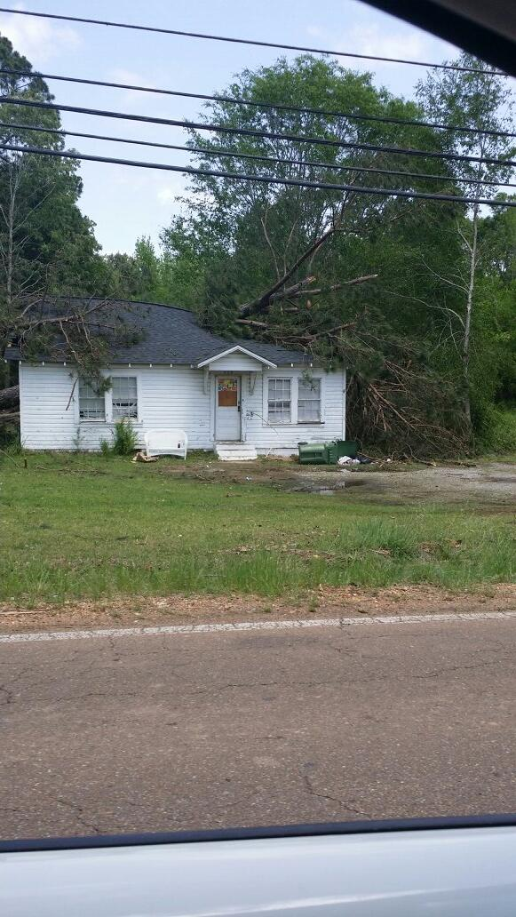 A house damaged right across the road from the Winston Country Medical Center which was heavily damaged by the EF4 tornado.