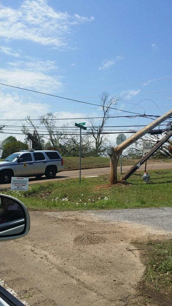 Broken trees, down power lines, and twisted street signs...never have I ever witnessed such a thing in person.