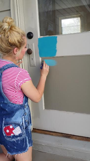 Testing out paint samples on the front door.