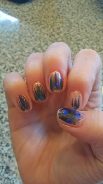 The right hand went semi-well...doesn't look horrendous but it is not offensive either...Just looked like I DIYed my nail art, which, in fact, I did *wink*
