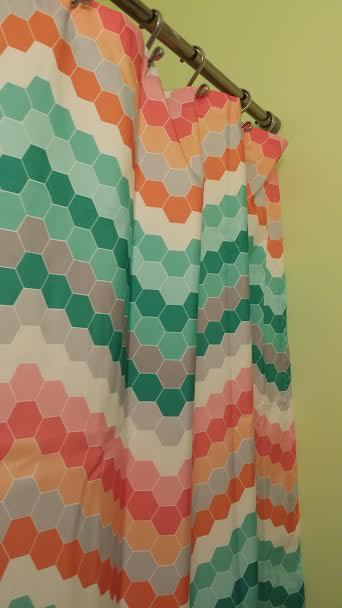 A sassy green bathroom with a funky and colorful shower curtain from Target. Love. Love. Love.
