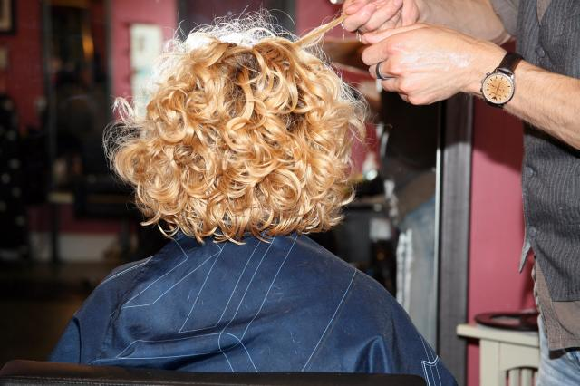 Oh, wow! Look at those curls!  In this photo, Chad is calming the frizz of the VIP's curls with Osis+ Thrill Texture Fiber Gum by Schwarzkopf.