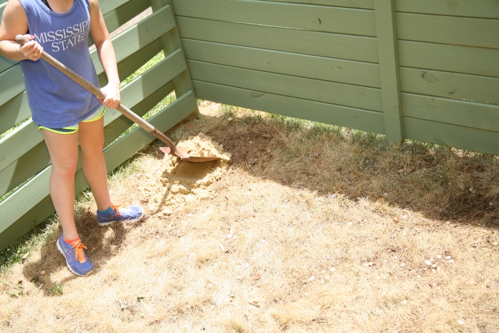 TIP (part one): Use a flat head shovel to distribute sand to uneven sections of ground.