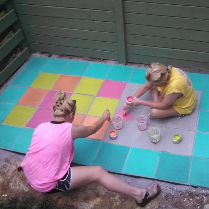Mom and I color-staining my patio. The artist, herself, came up with the color-blocking design...I just picked out the colors *wink*
