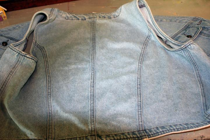 Step 1:  Lay out your vest with the back panel facing up.