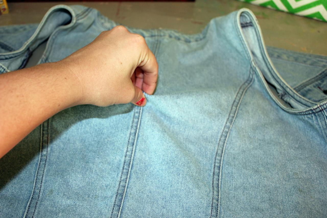 "Step 2: Pinch a tiny piece of the denim pulling it up into a ""unicorn horn"". NOTE: If you have ever tie-dyed, it is the same method starting out *wink*"