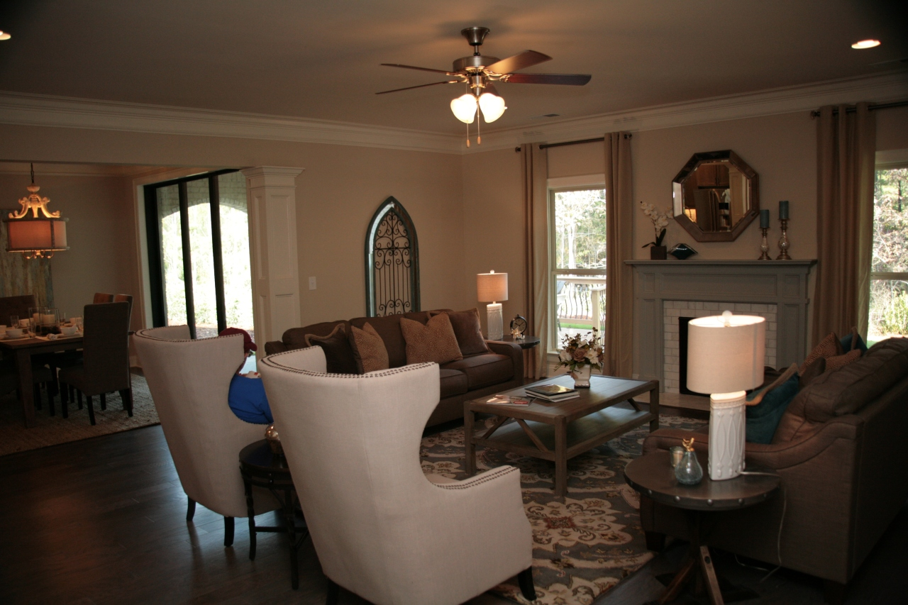 What a spacious living room! I love the open concept that flows effortlessly into the kitchen.