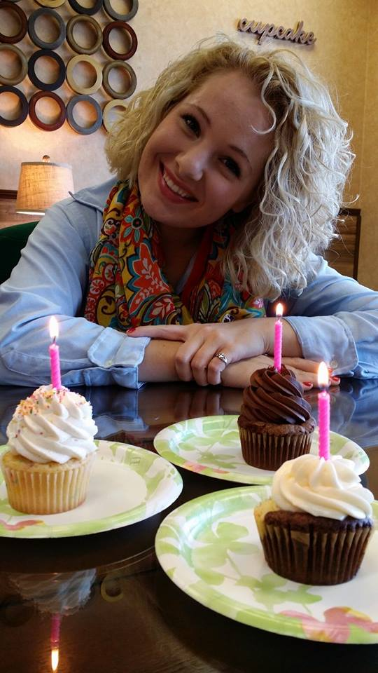 "A photo taken by my lovely Deddy at Cakes in a Cup in Johnson City, Tennessee. My mom and I enjoyed gluten-free cupcakes (we are both Celiac) and my dad had a ""normal"" Birthday Cake flavored one :)"