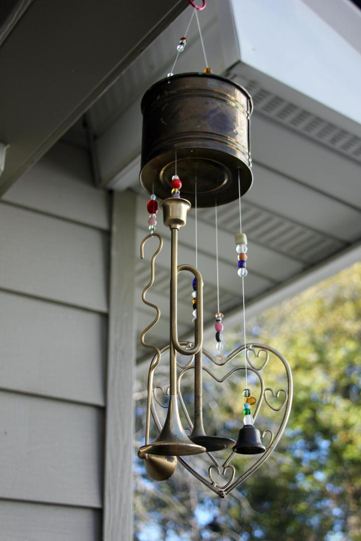 I FINALLY put up my upcycled wind chimes that I got over the summer...with the help of my dad, of course *wink*
