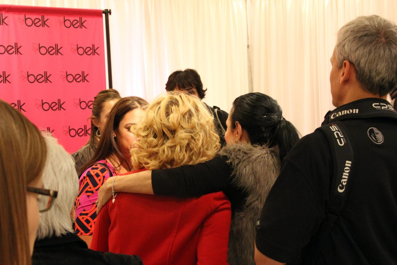 Arlene Golstein (in the fur), the VP of Trend Mechandising and Fashion Direction at Belk, and the VIP (in the red coat) chatting with other bloggers at brunch in Charlotte. Oh, I just love Arlene!