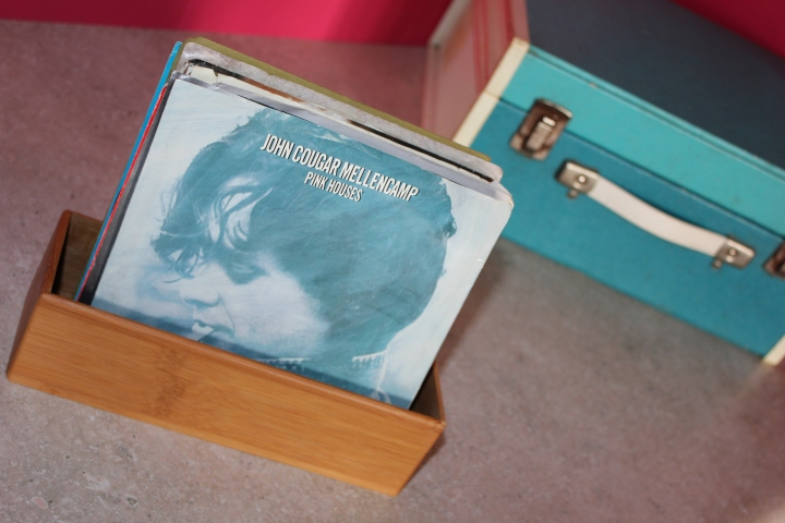 I am using a random bamboo drawer organizer to house my 45 records. This is better than trying to stack them with my 33s--it limits the possibility of tearing a cover or even losing a record.