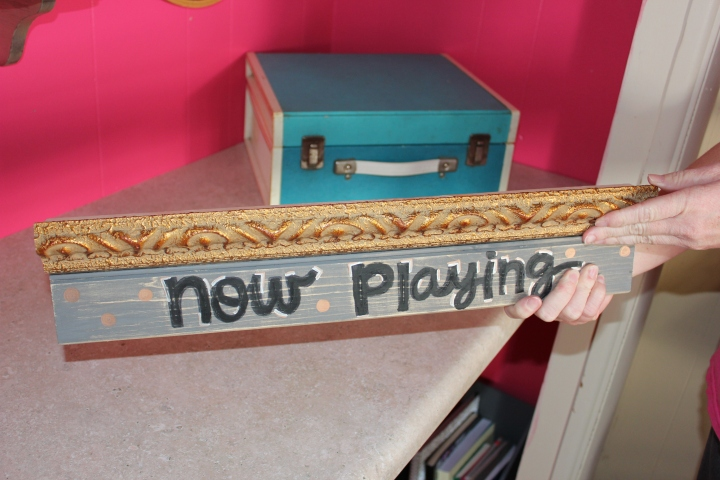"A ""Now Playing"" record stand upcycled from scrap wood and picture frame molding."