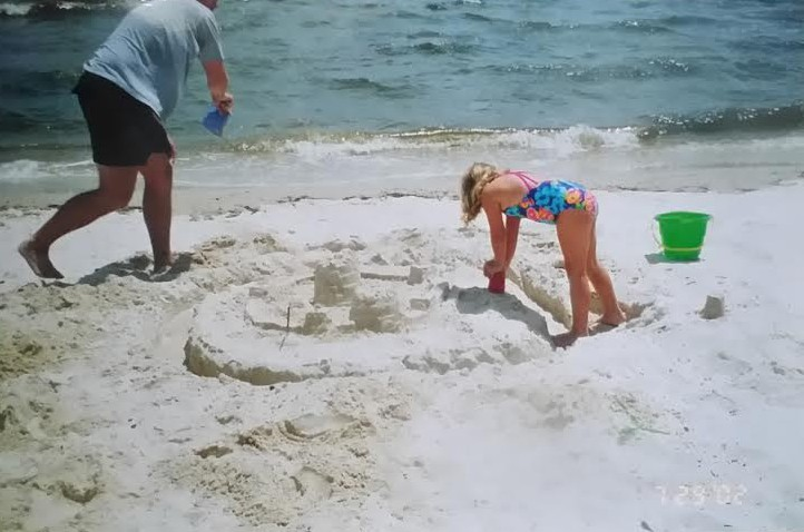 My Deddy and I making sandcastles. Having a dad with an engineer-brain came in handy when trying to build the biggest and baddest sandcastles on the beach.