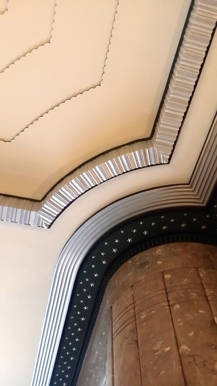 Check out those moldings! AND--they're metallic. I am in love *wink*