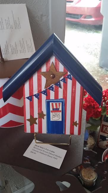 "My mom's other art piece, ""Uncle Sam's Fair Cabin"" was displayed at The Nest Interiors and Gifts. Such a sweet little store that I had never visited before the Jonesborough Days Artwalk!"