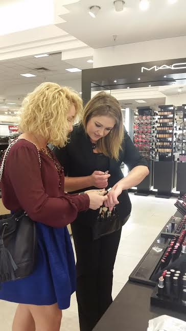 Brittney and the VIP chatting about lipstick hues.