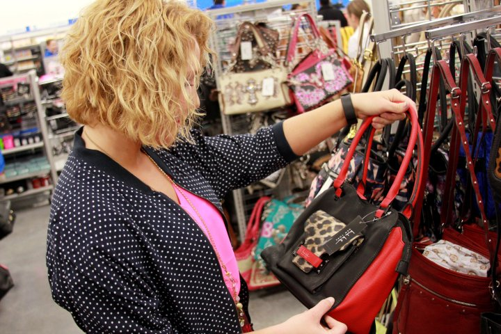 Now--clothes and shoes aside...Gabe's has a totally amazing selection of top brand handbags! I loved this red, black and leopard one <3