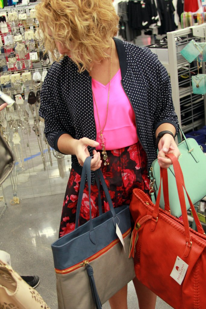 The VIP, aka THE extreme purse addict, trying to make a handbag decision . Be sure to come back Wednesday to see which one was the lucky winner *wink*